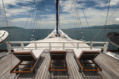 Cruising the Indonesian Archipelago. The pinisi or phinisi is a traditional Indonesian two-masted sailing ship. These boats are made to ply the waters of the stock photography