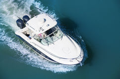 Cruising motor boat with two motors aerial. Aerial photograph of a motor boat with two motors cruising through blue water Royalty Free Stock Photos