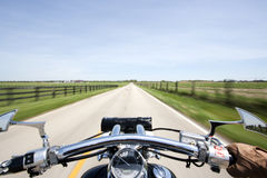 Cruising on motorcycle stock image