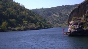 Cruising through narrow gorge or canyon on the Douro river near the Carrapatelo dam in northern Portugal