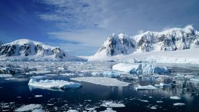 Cruising through the Neumayer channel full of Icebergs in Antarctica.  stock photo