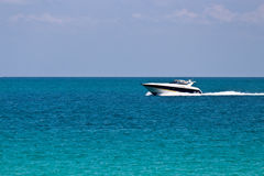 Cruising the ocean with a luxury boat Stock Images