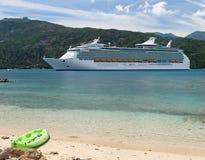 Cruising in Paradise. Cruiseship anchoring in a caribbean bay Stock Photo