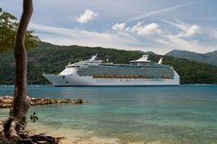 Cruising in Paradise. Cruiseship anchoring in a caribbean bay Stock Images