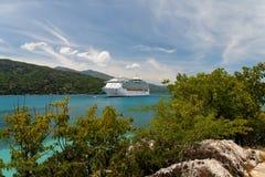 Cruising in Paradise. Cruiseship anchoring in a caribbean bay Royalty Free Stock Image