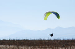 Cruising Paraglider. Paraglider Cruising along the ground in sitting position Royalty Free Stock Images