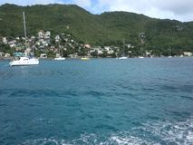 Cruising past yachts anchored in the caribbean by ferry stock video footage