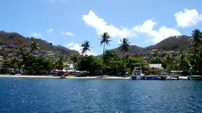 Cruising through a peaceful bay in the caribbean stock footage