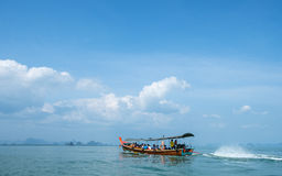 Cruising Phang Nga Bay in Thailand. Unidentifiable tour boat among the scenic limestone islands in Phang Nga Bay. This is one of Thailands most iconic tourist Royalty Free Stock Photos