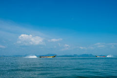 Cruising Phang Nga Bay in Thailand. Unidentifiable tour boats cruising in opposite dircetions at Phang Nga Bay. This is one of Thailands most iconic tourist Stock Image