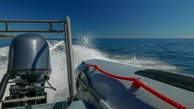 Cruising in a RIB rigid inflatable boat on a sunny day. With deep blue sky stock photo