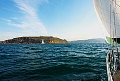 Cruising Sailing Yacht, at sea under sail. Cruising Sailing Yacht, under sail, at sea heading to the safe harbour of Broken Bay, New South Wales, Australia Stock Images