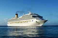 Cruising ship. Big cruising ship approaching Scarborough harbor. Tobago. Caribbean sea royalty free stock photo
