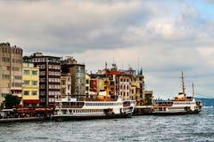 Cruising ship docking on Galata pier on Bosporus, Istanbul royalty free stock photo