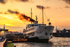 Cruising ship docking at pier on Bosporus in Istanbul Royalty Free Stock Photography