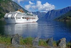 Cruising ship in the fjord Royalty Free Stock Image