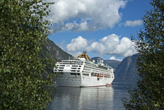 Cruising ship in the fjord Royalty Free Stock Photography