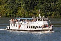 Cruising ship full of people on Danube river Royalty Free Stock Image