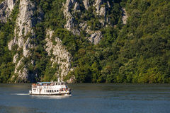 Cruising ship full of people on Danube river. Romania, Orsova town by the Danube river - July 30, 2016 -  Large group of people on a cruising ship traveling on a Stock Photos