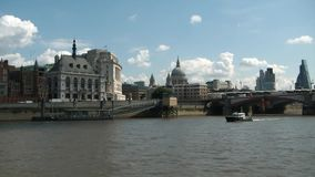 Cruising on thames river, london, cathedral of saint paul stock footage