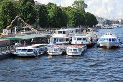 Cruising tourist ships dock on the Neva river in St. Petersburg Royalty Free Stock Photo