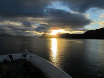 Cruising toward sunset at sea. Photographed from bow of ship Stock Photo