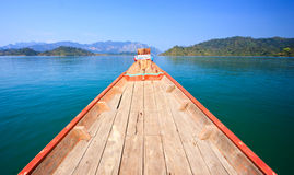 Cruising with wooden boat in clear blue sky Stock Photo