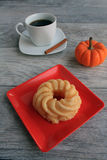 Cruller dough nut with mug of pumpkin spice coffee Royalty Free Stock Image