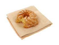 Cruller doughnut on cloth napkin bitten Stock Photography
