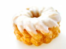 Cruller with icing isolated on white background Stock Image