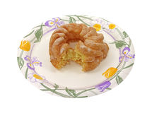 Cruller on paper plate Royalty Free Stock Images