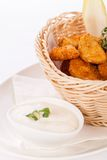 Crumbed chicken nuggets in a basket Royalty Free Stock Image