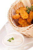 Crumbed chicken nuggets in a basket Royalty Free Stock Images