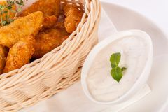 Crumbed chicken nuggets in a basket Royalty Free Stock Photos