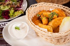 Crumbed chicken nuggets in a basket Stock Images