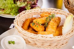 Crumbed chicken nuggets in a basket stock photos