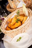 Crumbed chicken nuggets in a basket Royalty Free Stock Photo