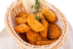 Crumbed chicken nuggets in a basket Stock Image