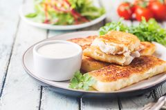 Golden fried fish fingers royalty free stock photo