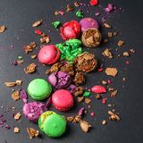 Colored Crumbed Macaroons on a black background, directly above. Crumbed Macaroons on black background, flat lay view royalty free stock photography