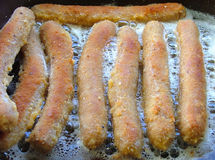 Crumbed sausages. Cooking crumbed sausages royalty free stock image