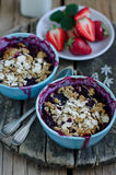Crumble. Crumb with strawberry and bilberry Royalty Free Stock Photos