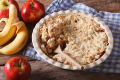 Crumble with apple and banana close-up, horizontal, rustic Royalty Free Stock Images