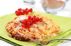Crumble cake. Crisp crumble cake topped with red currant royalty free stock photography