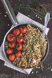 Crumble with cod fish, cherry tomatoes and seeds Royalty Free Stock Photos