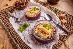 Crumble in glass dish. Crumble with raspberries, gooseberries, blackberries and cinnamon Royalty Free Stock Images