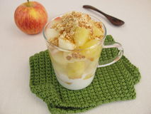 Crumble mug cake with apple, yogurt cookie crumbs and almond brittle Stock Photos