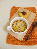 Crumble mug cake with peach from microwave Royalty Free Stock Images