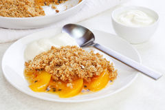 Crumble with Peach and Passion Fruit Stock Photography