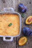 Crumble with plums and cinnamon Stock Images